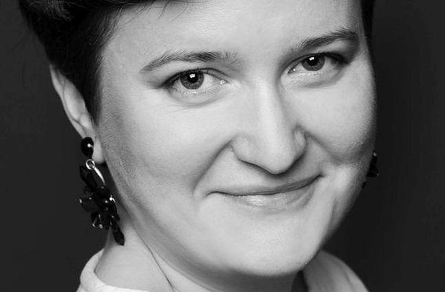 Anna Wibig, fotografka specjalizującasię w reportażach z narodzin.